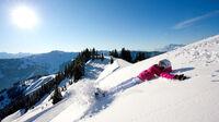 © SalzburgerLand Tourismus / SalzburgerLand - Frau im Schnee / Zum Vergrößern auf das Bild klicken